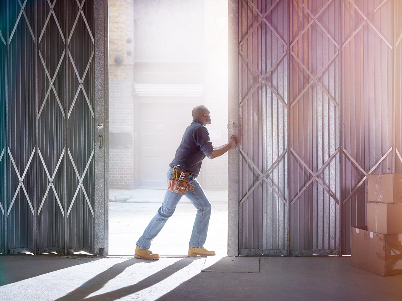 Image of a man opening the door of a warehouse